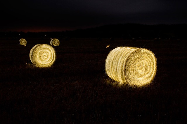 A picture of glowing haystacks