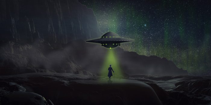 A depiction of a UFO hovering over a person