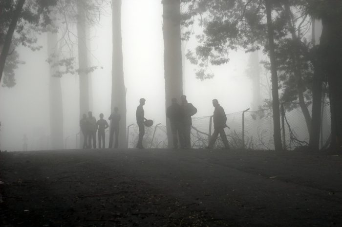 A misty scene with a search party preparing to go to work