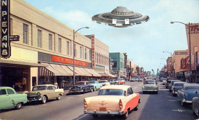 A superimposed UFO over a typical 1950s California street