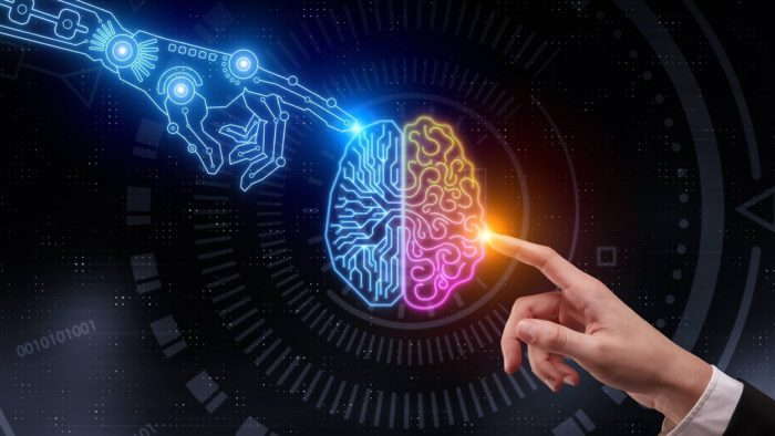 A picture of a glowing human mind with a robot finger touching one side and a human finger touching the other