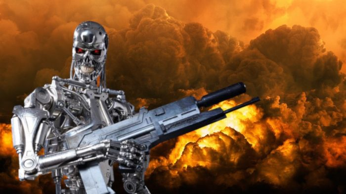 A Terminator-like robot with a gun and fire in the background