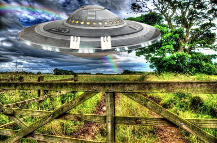 A superimposed UFO over a field in the country