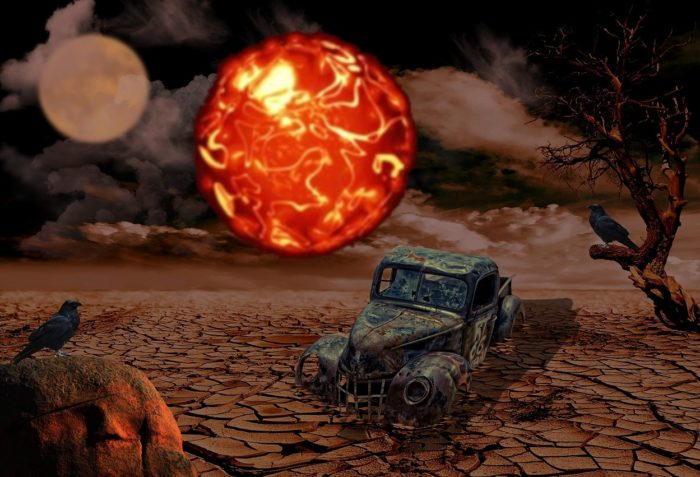 A depiction of a ruined car with a glowing orb hovering over it