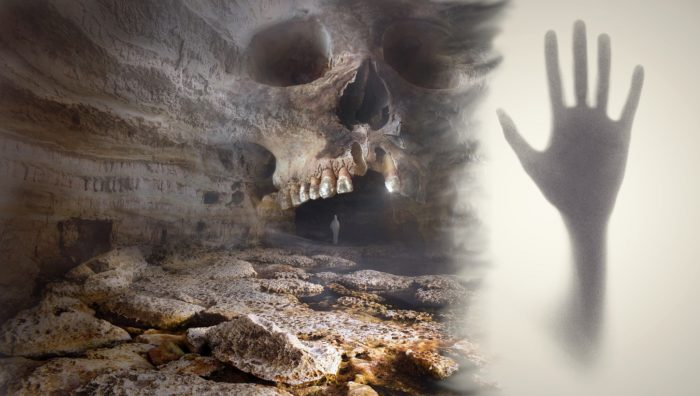A Depiction of cave carved into a skull blended into an image with a hand coming out of a mist