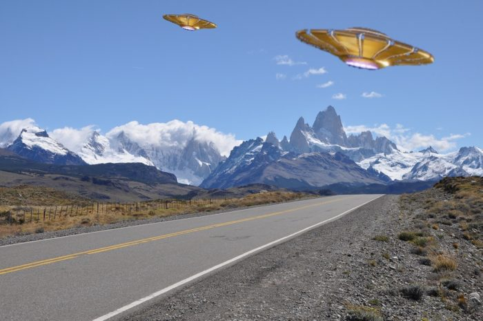 Superimposed UFOs on a picture of a lonely road