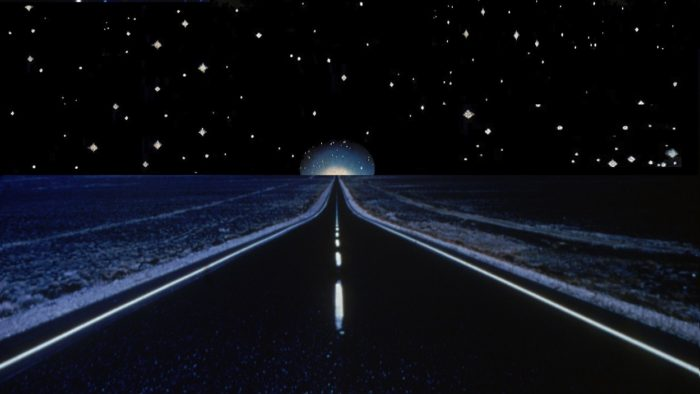 A depiction of a lonely road at night