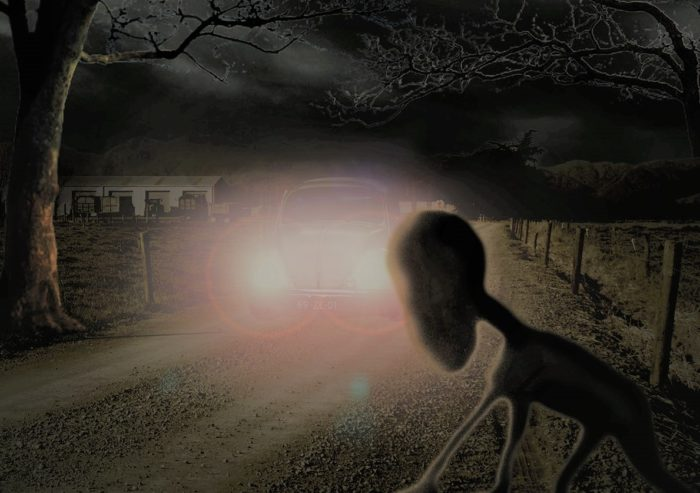 A depiction of the Dover Demon with a car approaching