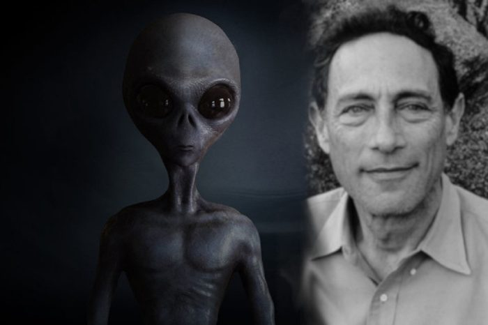 John Mack blended into an image of an alien entity