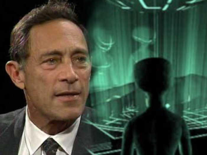 John Mack blended into a picture of an alien entity