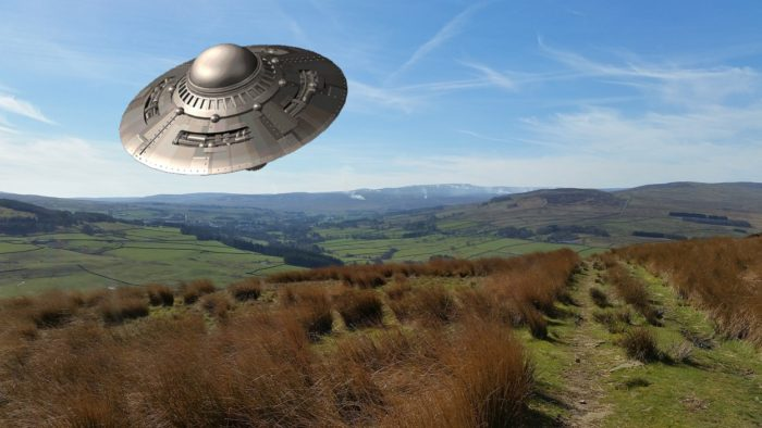 Superimposed UFO over the English countryside