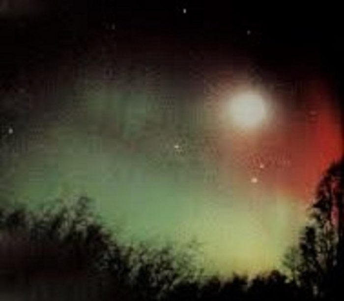 A depiction of a starry sky with aurora