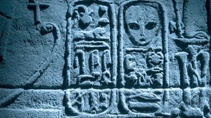 Ancient carvings appearing to show and alien