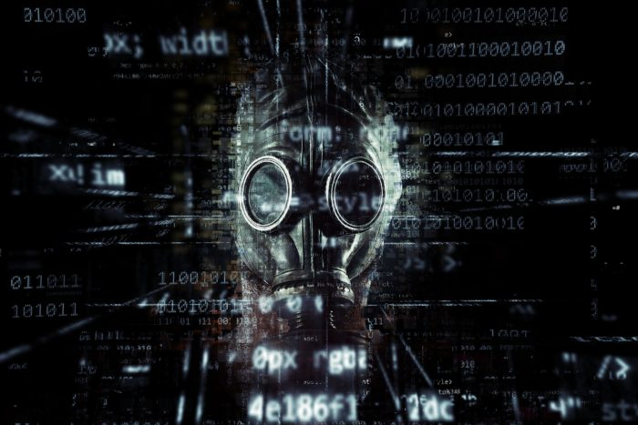 A gas mask superimposed onto a screen of digital information