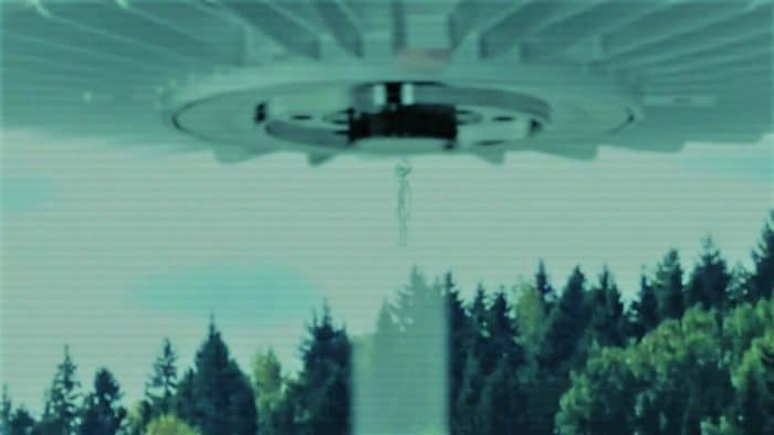 A depiction of a person being drawn into a UFO