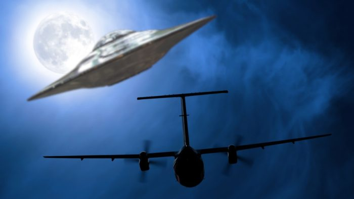 A depiction of a UFO following a plane at night