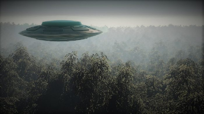 A depiction of a UFO hovering over a forest