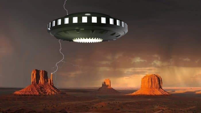 A depiction of a UFO over the desert in Arizona with a stormy sky
