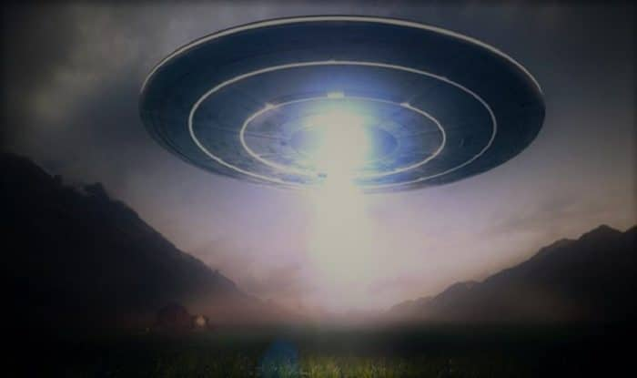 A depiction of a UFO in a mountain range