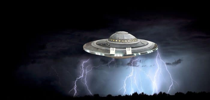 A depiction of a UFO in a night sky