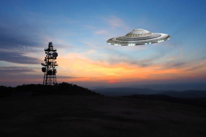 A superimposed UFO near a radio tower