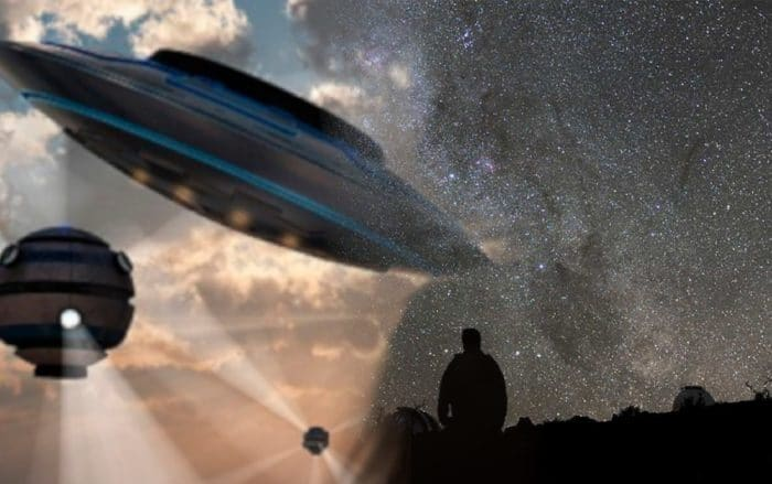 A blended picture of UFOs into a man looking at the stars