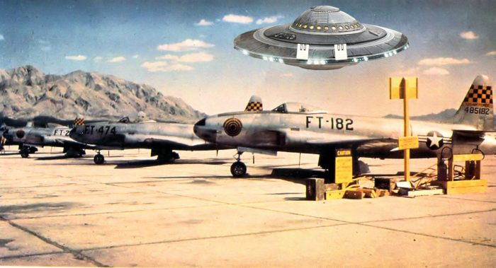 UFO superimposed over 1950s Nellis Air Force Base