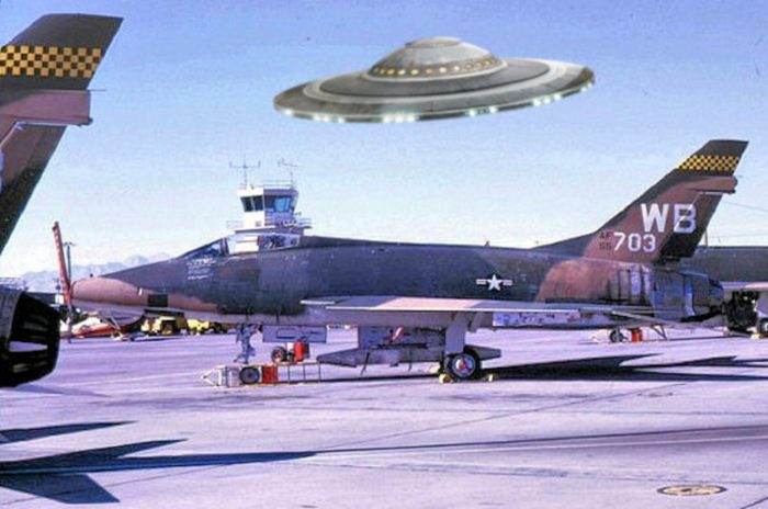 A superimposed UFO over an airfield