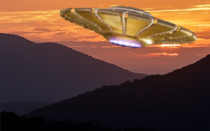 A depiction of a golden UFO flying over the mountains