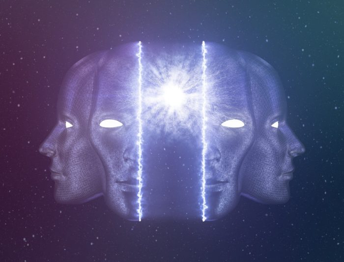 A human head in space splitting to reveal an inner light