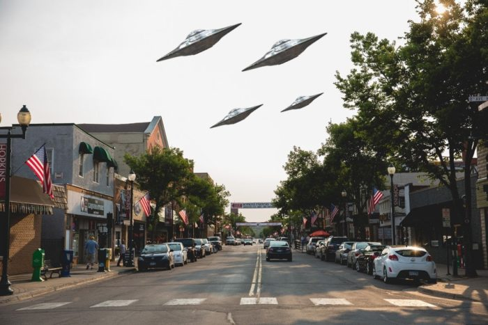 A depiction of UFOs over a New Mexico street