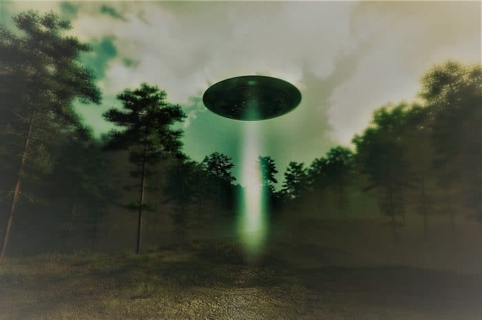 A depiction of a UFO over with a shining light