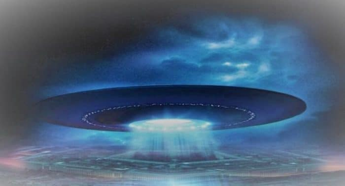 A depiction of a UFO over a field