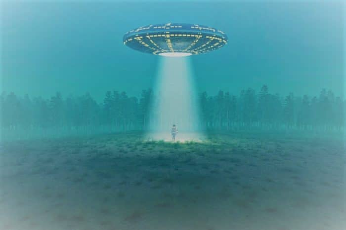 Depiction of a UFO shining a light on a person
