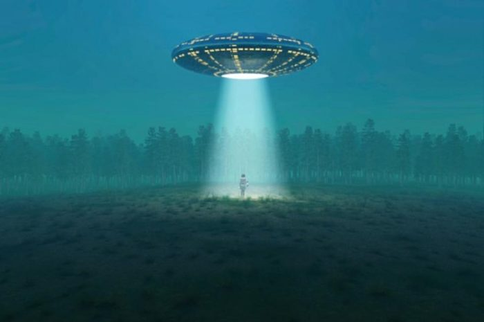 A depiction of a UFO shining a light on a person