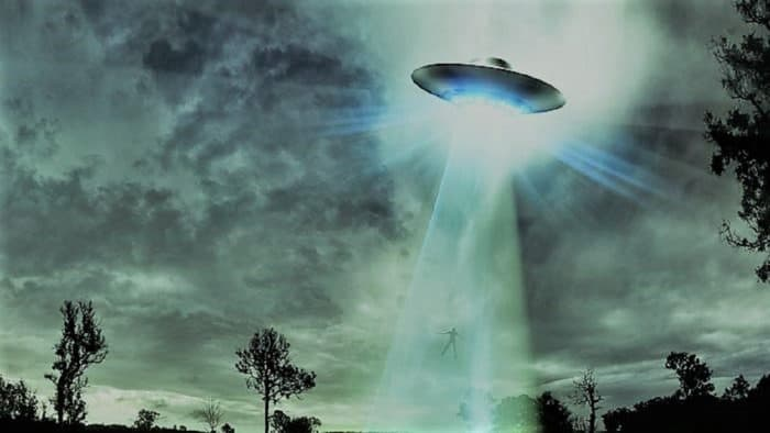 A depiction of a UFO in the cloudy sky