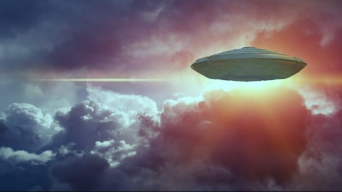 A depiction of a UFO in a cloudy sky