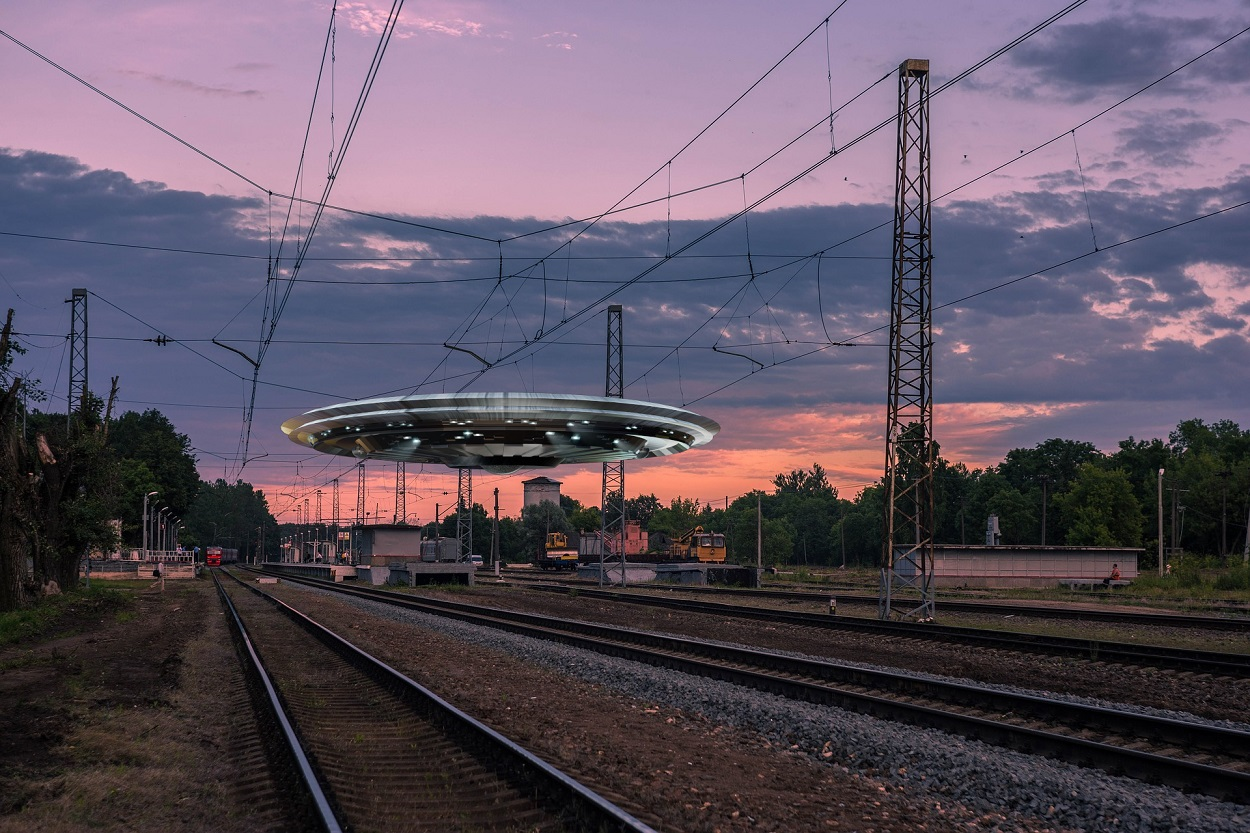 A depiction of a UFO over a railtrack