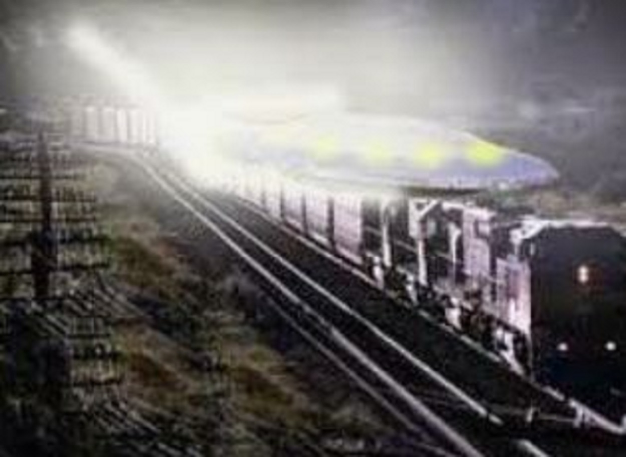 A depiction of a UFO over a train
