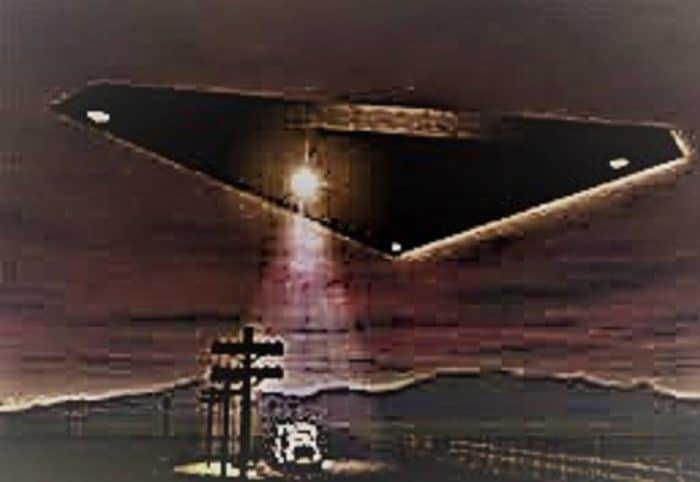 Depiction of a black triangle UFO shining a light on a truck