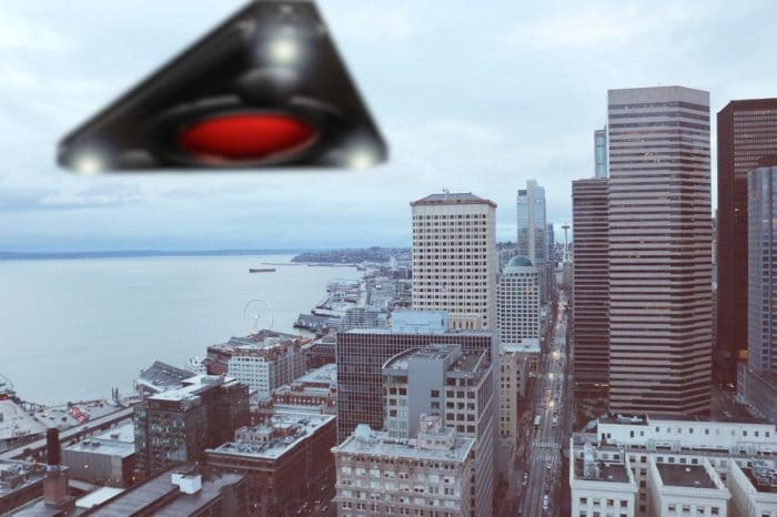 Depiction of Black triangle UFOs over an American city