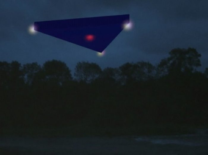 Depiction of a black triangle UFO over woodland