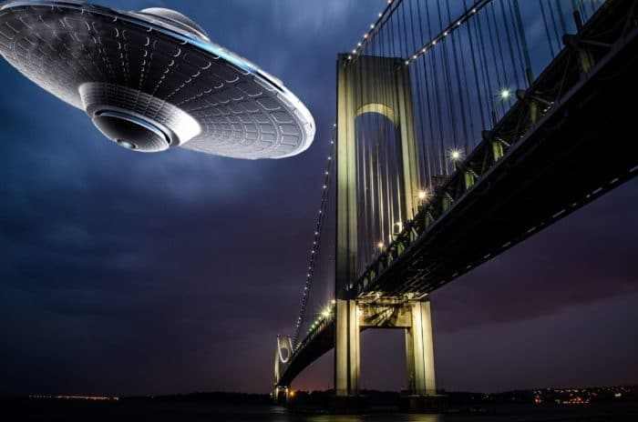 A depiction of a UFO over the Brooklyn Bridge