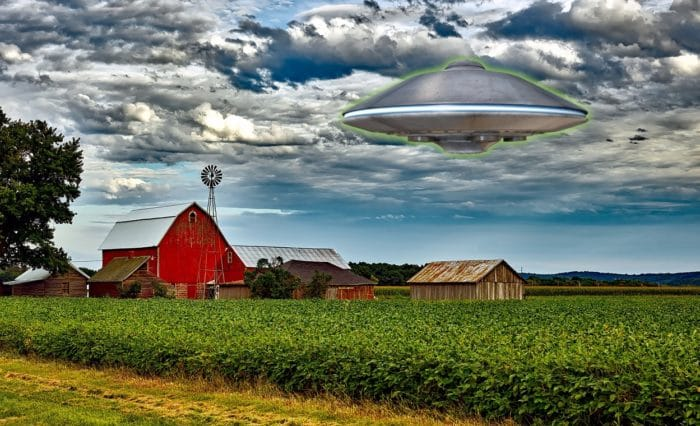 A depiction of a UFO over a farmer's field