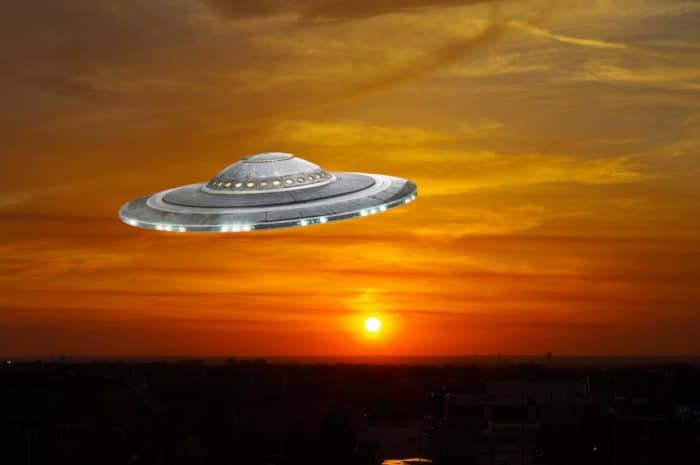 A superimposed UFO in a sunset sky