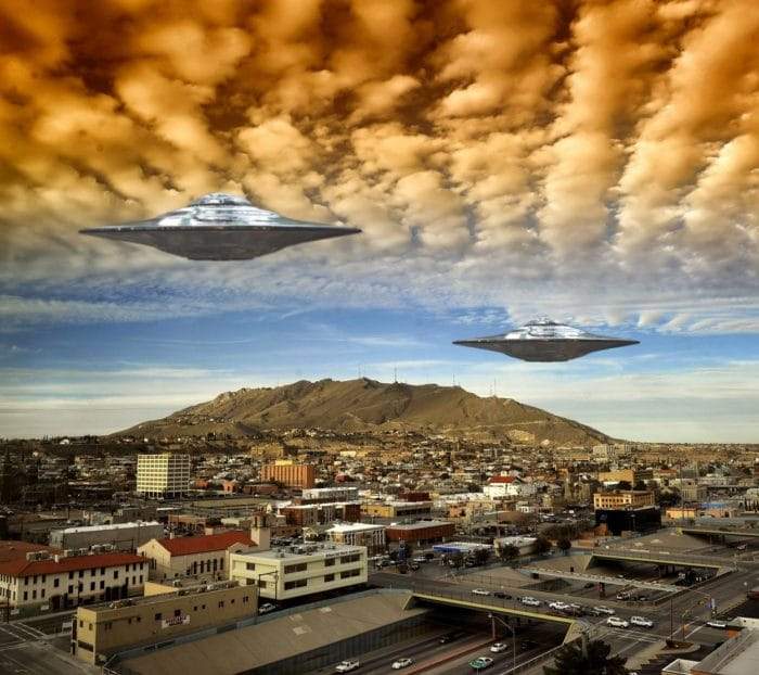 Two superimposed UFOs in a cloudy sky