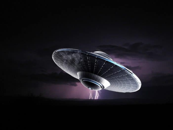 A depiction of a UFO against a lightning sky