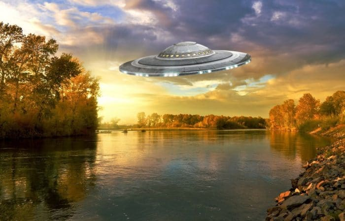 A depiction of a UFO over a river