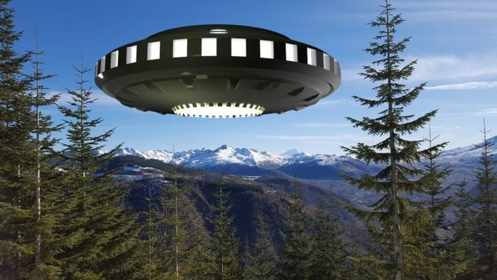 A superimposed UFO over trees in Washington State