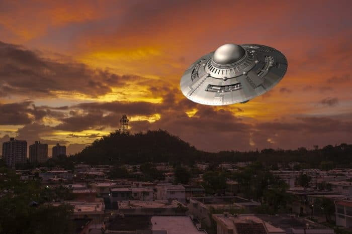 A depiction of a UFO over a city